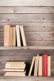 old-books-on-a-wooden-shelf-PMPD5DQ